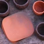 Svečturi. Izgatavoti no Latvijas brūnā māla. Nav glazēti.Svēpētā keramika, slāpētā keramika, melnā keramika, roku darbs, hand made, craftman, ceramica, food fired, Latvia, Kandavas keramikas ceplis
